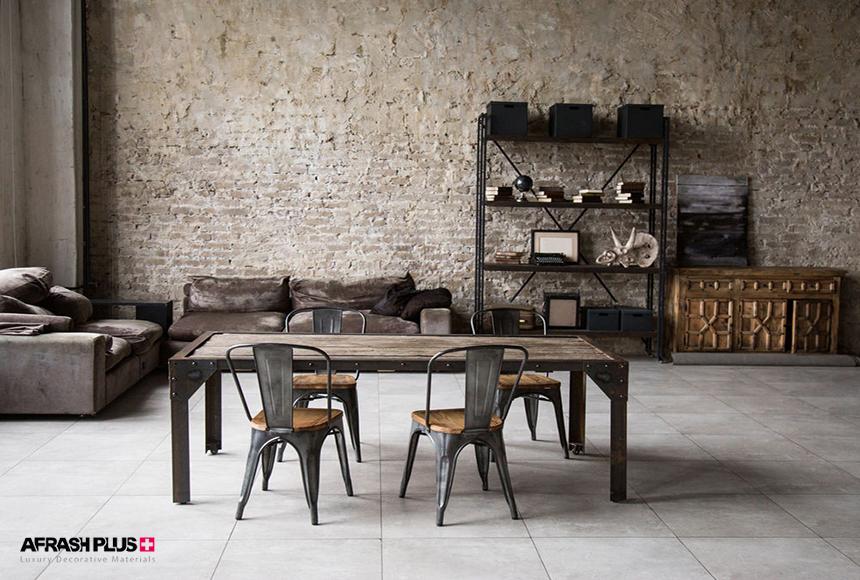 نشیمن با سبک صنعتی، دیوار آجری و مبلمان مخمل و میز و صندلی چوب وفلز
