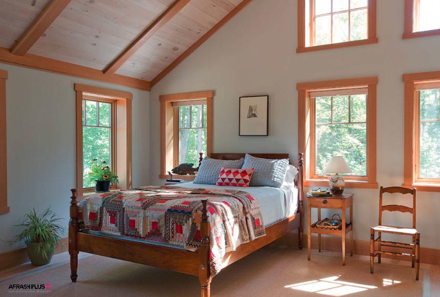 اتاق خواب سبک هنرمند با سقف شیروانی و پنجره فراوان