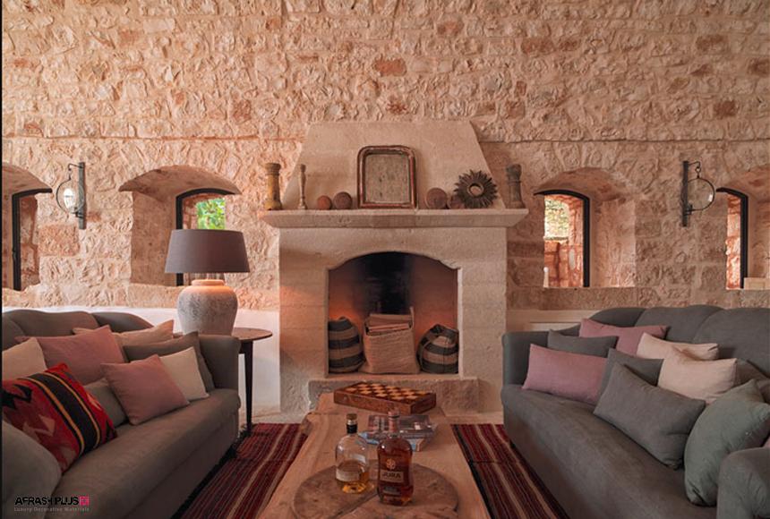 نشیمن سبک مدیترانه ای با دیواره و شومینه سنگی