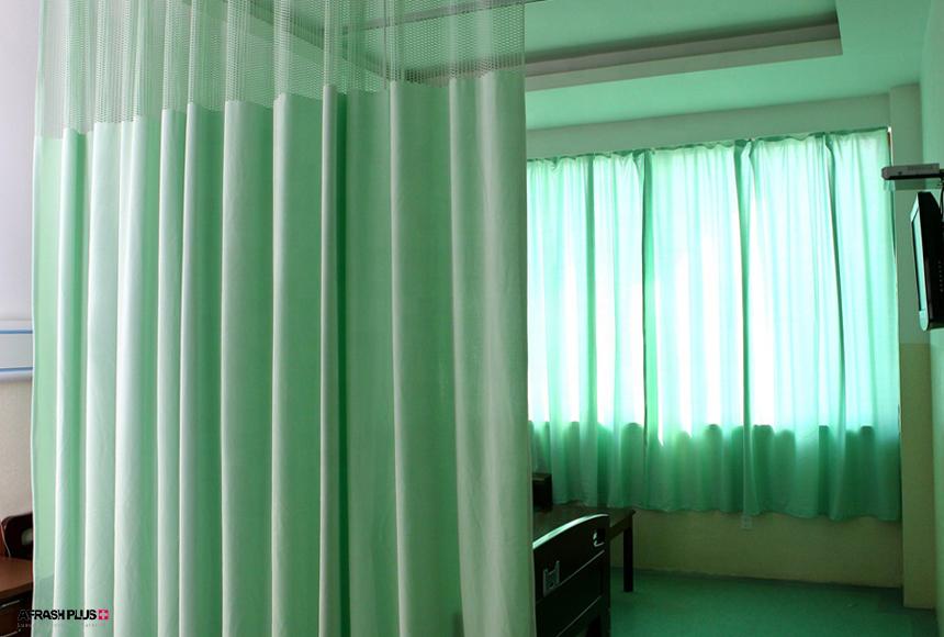 اتاق بیمار در بیمارستان با تم رنگ سبز