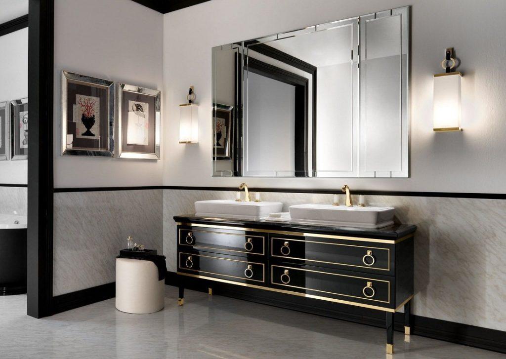 سرویس بهداشتی با روشویی مشکی و طلایی همراه با یه اینه بزرگ