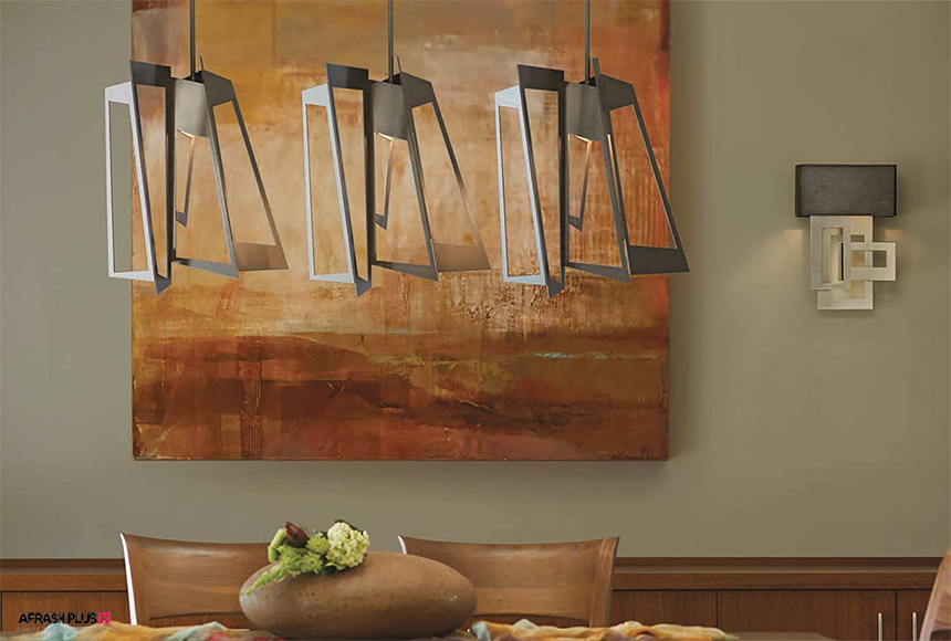 استفاده از لامپ خلاقانه فلزی بر روی میز نهار خوری