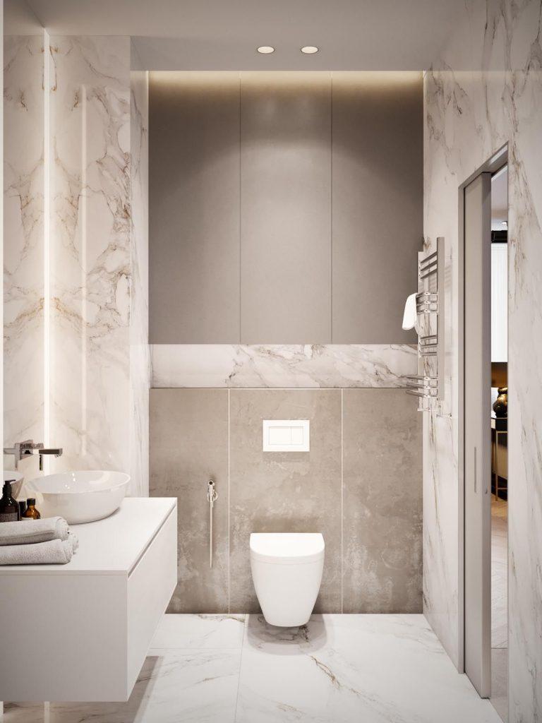 استفاده از رنگ کرم با رنگ سفید در سرویس بهداشتی کوچک که باعث بزرگتر دیده شدن فضا شده است